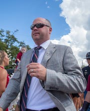 Troy's new football head coach Chip Lindsey makes his entrance for the first game of the season against Campbell University.