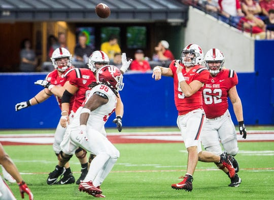 Ball State quarterback Drew Plitt attempts a pass during the Cardinals' season opener against Indiana. The Hoosiers defeated the Cardinals.