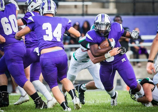 Central running back Shoka Griffin runs the ball against Yorktown at Central Friday, Aug. 30, 2019. Griffin finished with two touchdowns in the contest.