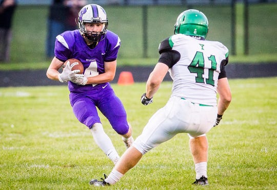 Muncie Central athlete Michael Goul slips past Yorktown's defense during their game at Central on Aug. 30, 2019.