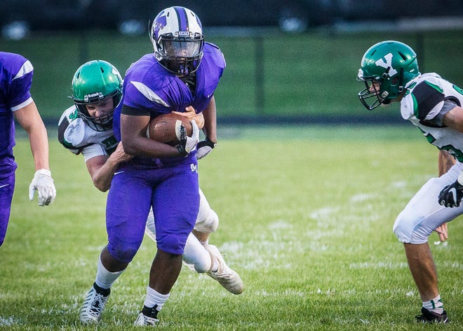 FILE -- Central running back Shoka Griffin runs the ball against Yorktown at Central Friday, Aug. 30, 2019. Griffin won The Star Press Football Player of the Week with his 212-yard game against Anderson in Week 3.