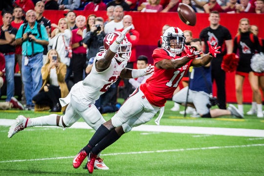 Ball State receiver Justin Hall attempts to make a catch during a game against IU at Lucas Oil Stadium Saturday, Aug. 31, 2019. IU defeated Ball State 34-24.
