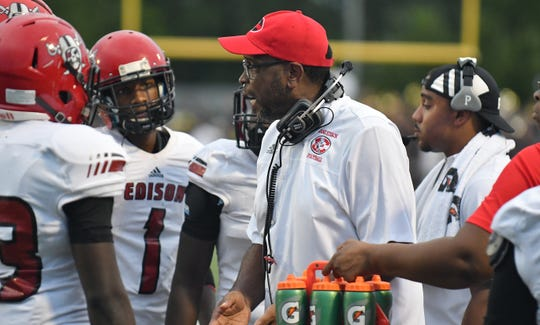Miami Edison Red Raiders head coach Luther Campbell, a former rapper for 2 Live Crew, on the sidelines of their game against Naples High School on Friday.