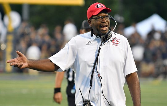 Miami Edison Red Raiders head coach Luther Campbell, a former rapper in 2 Live Crew, on the sidelines of their game against Naples High School on Friday.