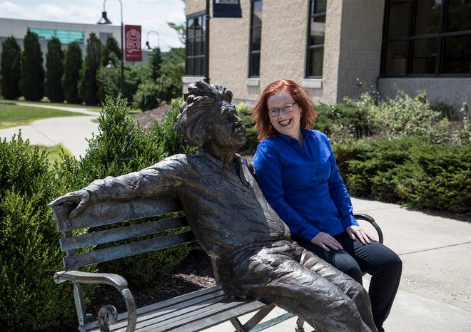 Renee VanSickle laughs as she sits next to a statue of Albert Einstein. VanSickle is a Floodplain Administrator and Stormwater Engineer 2 for the City of Columbus.