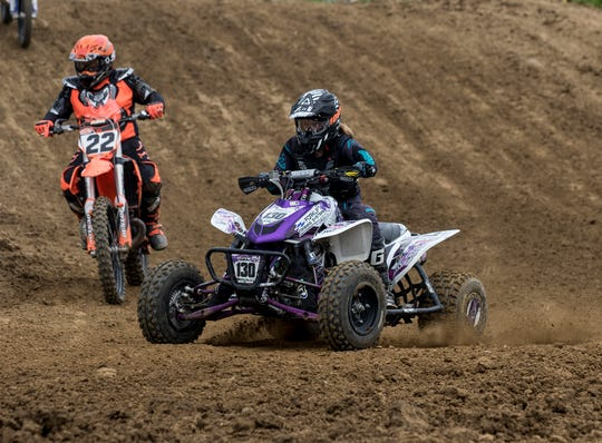 Kinsey Osborn (130), a Licking Valley 8th grader, rides on her father Jeremy Osborn's Briarcliff MX course. She is a nationally-known ATV motocross racer.