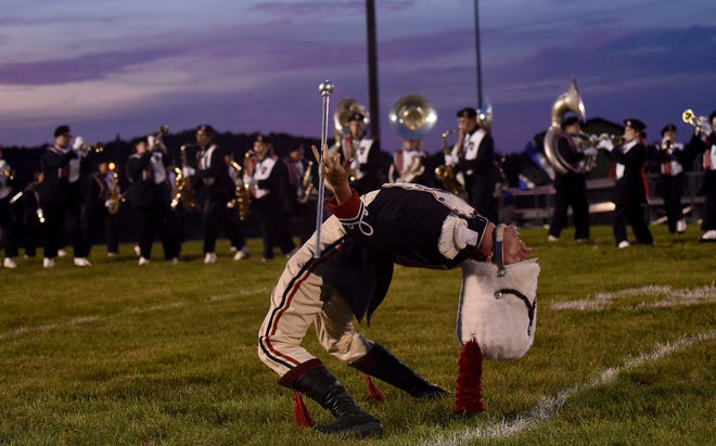 Lakewood senior drum major Austin Bowman performs with the Lancer band at halftime of the football game at River View.