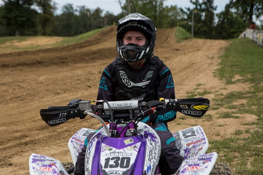 Kinsey Osborn, a Licking Valley 8th grader, is also a nationally-known ATV motocross racer. She is shown at her father Jeremy Osborn's track, Briarcliff MX.