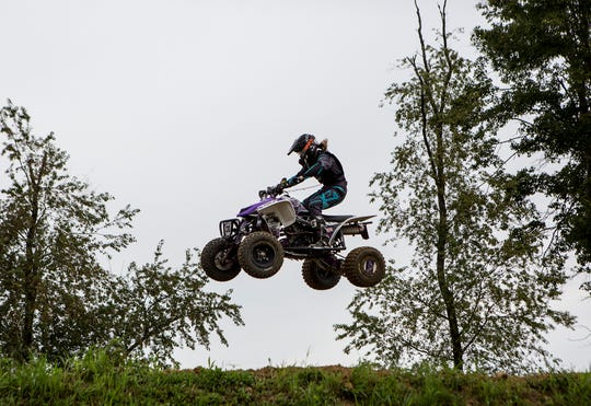 Kinsey Osborn, a Licking Valley 8th grader, makes a jump at her father Jeremy Osborn's Briarcliff MX track. She is a nationally-known ATV motocross racer.