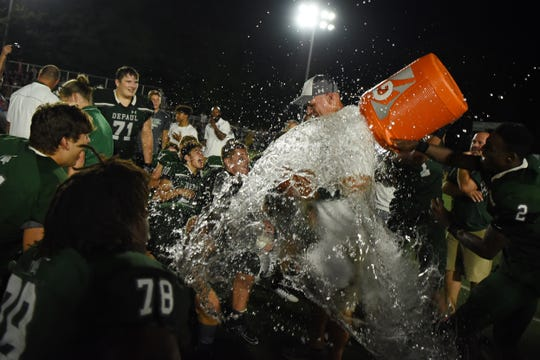 DePaul High School opens its football season hosting Pope John of Sparta in Wayne on Friday August 30, 2019. DePaul Head Coach John McKenna is doused with water after DePaul beats Pope John.