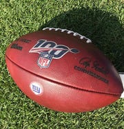 The commemorative NFL 100 football being used by the NY Giants this season, including the logo stamp.