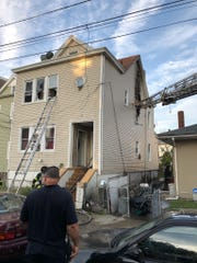 Multiple ladders had to be extended to the second story of this multi-family house on Fifth Street in Passaic to rescue residents during a fire that sparked there on the morning of Aug. 31.