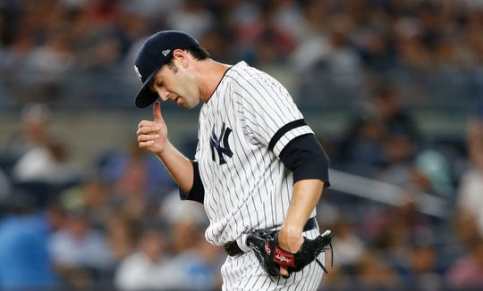 Yankees relief pitcher Cory Gearrin (35) reacts after giving up runs to the New York Yankees in the seventh inning at Yankee Stadium. Mandatory Credit: