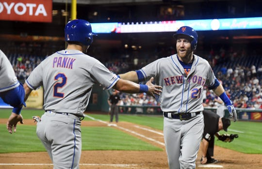 New York Mets third baseman Todd Frazier (21) celebrates with second baseman Joe Panik (2) after hitting a three run home run in the ninth inning against the Philadelphia Phillies at Citizens Bank Park.