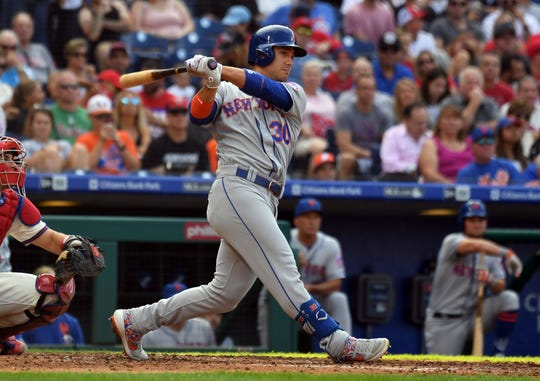 New York Mets right fielder Michael Conforto (30) hits an RBI double in the third inning against the Philadelphia Phillies at Citizens Bank Park.