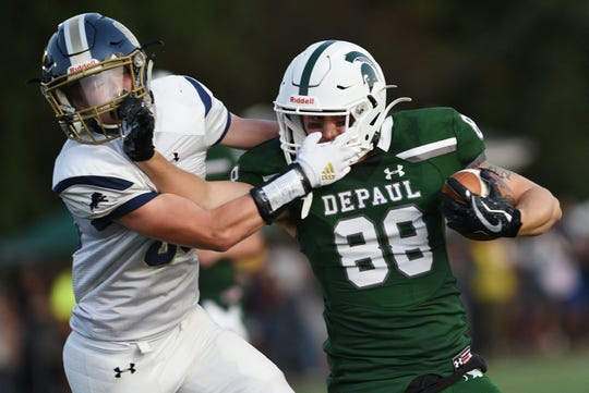 DePaul High School opens its football season hosting Pope John of Sparta in Wayne on Friday August 30, 2019. Pope John #85 Warren Lynch and DePaul #88 Nuccio Listiano.