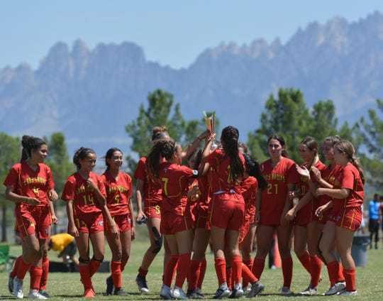 The Centennial Lady Hawks celebrate after taking this year's Las Cruces Public Schools Girls' Soccer Tournament on Saturday afternoon at Field of Dreams with a 3-0 win over Mayfield.  Photo taken 8/31/19.