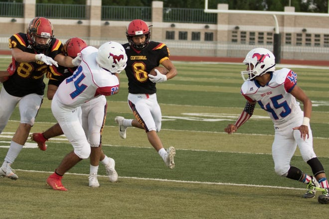 Centennial's Karsten Rueckner looks for the gap during the Hawks' 55-0 win over West Mesa on Friday, Aug. 30, at the Field of Dreams.
