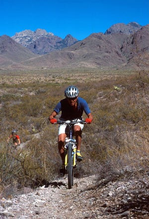 Mountain bikers enjoy a challenging ride on the Sierra Vista Trail in the foothills of the Organ Mountains.
