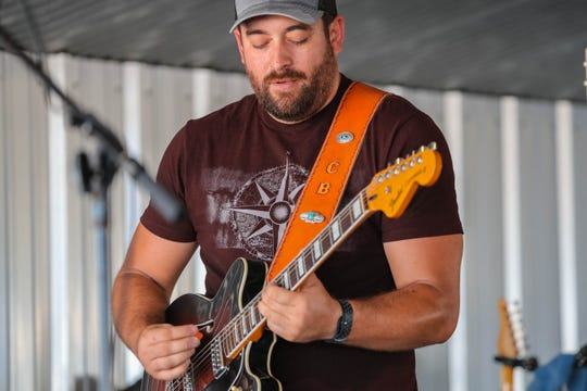 Chris Baker of the Chris Baker Band performs at the Hatch Chile Festival in Hatch on Saturday, Aug. 31, 2019.