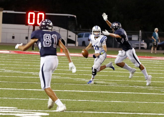 Carlsbad quarterback Kaden Smith tries to escape a Goddard defender during Week 2's game in Roswell. Goddard beat Carlsbad, 21-6.