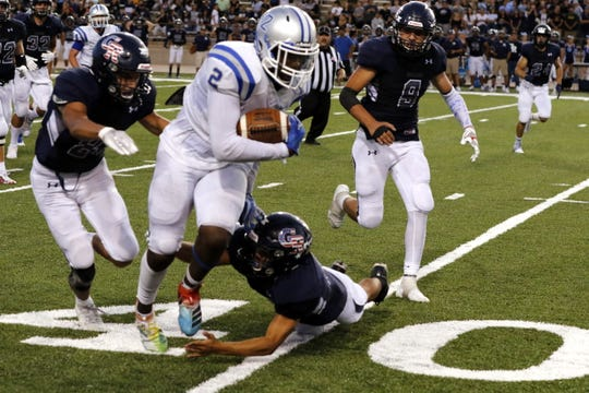 Carlsbad's Shamar Smith breaks a tackle by a Goddard defender during the Aug. 20 game in Roswell. Smith finished the 2019 season with 591 receiving yards, 114 rushing yards and 96 passing yards. He scored six offensive touchdowns and had a 55-yard interception returned for a touchdown against Goddard.  recorded a 55-yard interception for a touchdown, Carlsbad's lone score in the game.