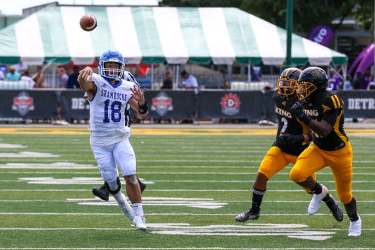 Catholic Central quarterback Jack Beno attempts a pass in a game against King on Aug. 31.
