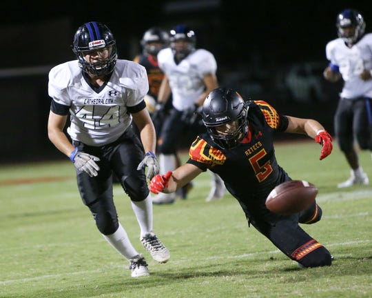 Cole Martello of Palm Desert tries to come up with the ball that was intended for a Cathedral City player on Aug. 30, 2019.