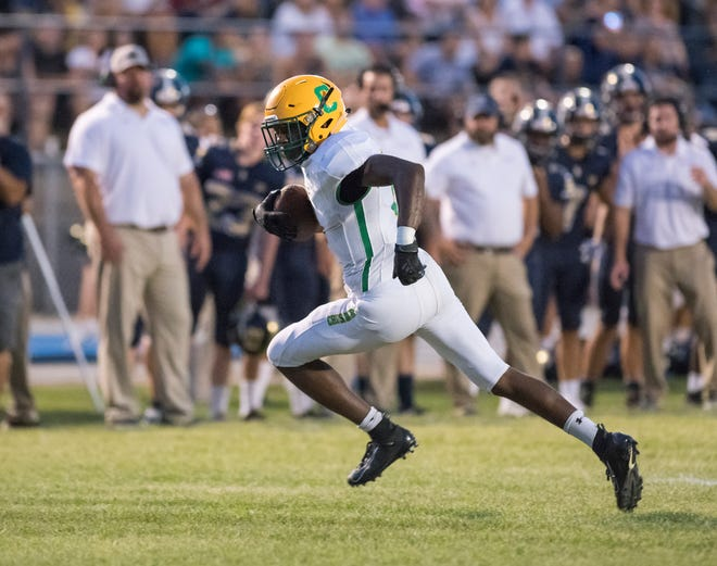 Michael Archie (8) finds open field during the Catholic vs Gulf Breeze football game at Gulf Breeze High School on Friday, August 30, 2019.