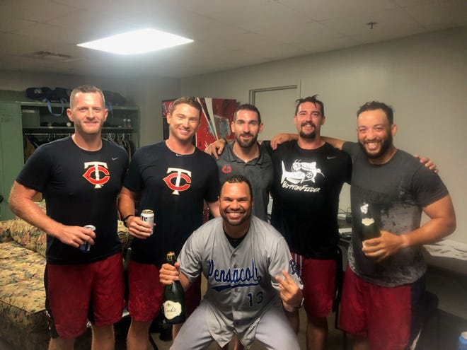 Pensacola Blue Wahoos players celebrate a fifth straight qualification to the Southern League playoffs on Aug. 30, 2019.