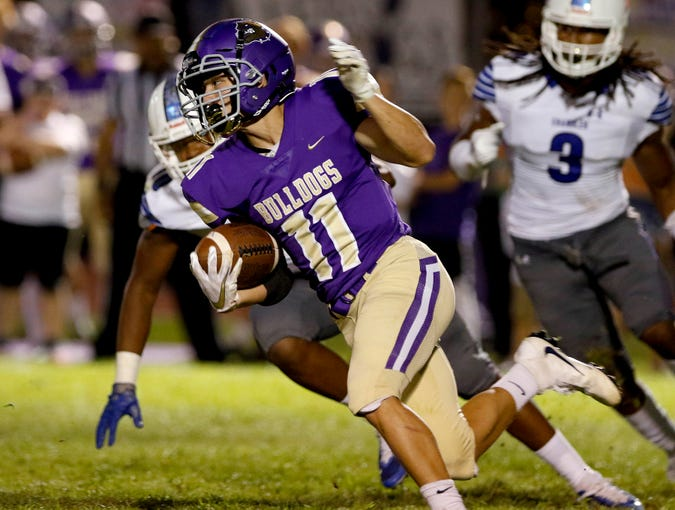 Queen Creek's Jace Bond (11) looks for running room against Chandler during their game in Queen Creek. (Darryl Webb/For the Republic)