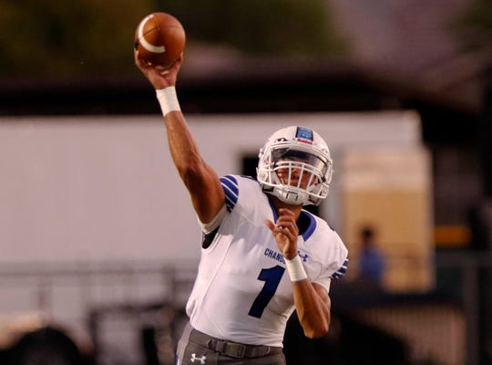 Chandler quarterback Mikey Keene throws against Queen Creek's during the first half of their game in Queen Creek. (Darryl Webb/For the Republic)