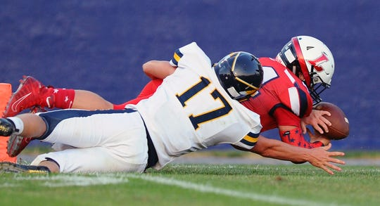 Lebanon's Andrew Bowers(44) dives into the end zone for a Lebanon TD  during the game between the Elco Raiders and the Lebanon Cedars held Friday Aug.30,2019 at Lebanon High School Alumni Stadium.