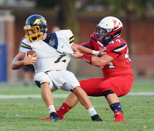 Elco QB Braden Bohannon (17) is pulled down for a loss by Lebanon's Andrew Bowers (44) during a game between the Elco Raiders and the Lebanon Cedars held Friday, Aug.30,2019 at Lebanon Alumni Stadium.
