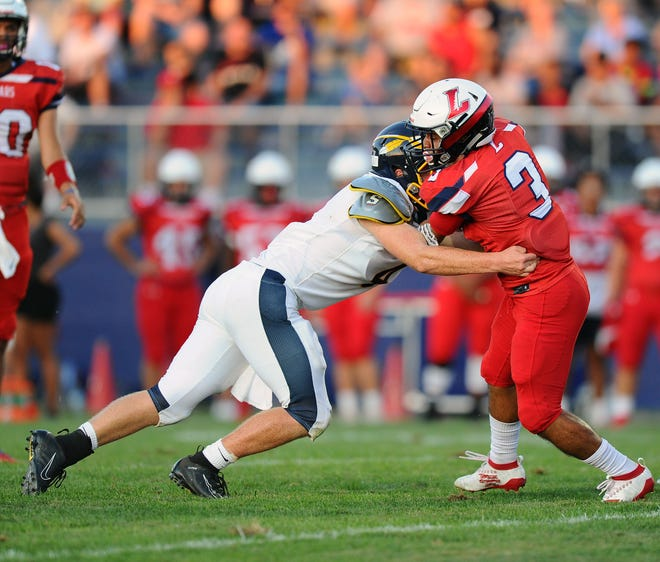 Lebanon's Joseph Mejias-Rios(3) is stopped by Elco's Cole Thomas(4) during  the game between the Elco H.S.Raiders and the Lebanon H.S.Cedars held Friday Aug. 30, 2019 at Lebanon High School Alumni Stadium.