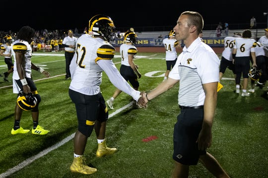 Red Lion offensive coordinator Taylor Green celebrates with Red Lion's Kairen Gordon-Bey (52) after winning a football game between Waynesboro and Red Lion, Friday, Aug. 30, 2019, in Waynesboro. The Red Lion Lions defeated the Waynesboro Indians 14-12.