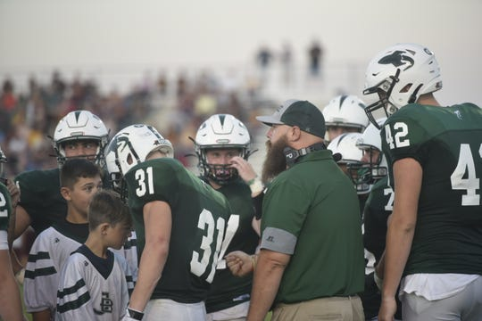 James Buchanan head coach David Miller chats with his team during a timeout against Big Spring on Friday, August 30.