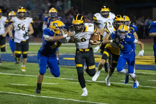Red Lion's Nic Shultz (9) runs the ball during the second half of a football game between Waynesboro and Red Lion, Friday, Aug. 30, 2019, in Waynesboro. The Red Lion Lions defeated the Waynesboro Indians 14-12.