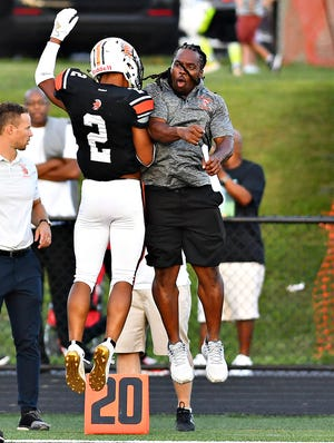 York Suburban's Savion Harrison, left, celebrates after scoring a touchdown last year. The status of the 2020 high school fall season is in limbo.