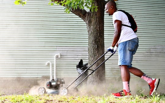 Brandt Kingsley, of York City, who is founder of Pedal for Peace, mows as clean-up begins on East Charles Way as Black Star Action Network International launches the first York City Be Clean Campaign in York City, Saturday, Aug. 31, 2019. Dawn J. Sagert photo