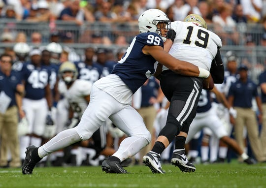 Aug 31, 2019; University Park, PA, USA; Penn State Nittany Lions defensive end Yetur Gross-Matos (99) sacks Idaho Vandals quarterback Colton Richardson (19) during the second quarter at Beaver Stadium. Mandatory Credit: Matthew O'Haren-USA TODAY Sports