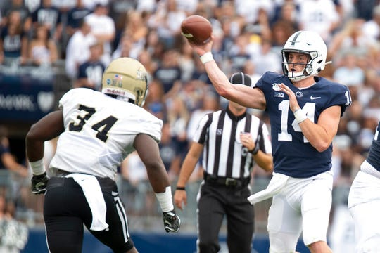 Penn State quarterback Sean Clifford (14) passes over Idaho linebacker Leo Tamba (34) during the second quarter Aug. 31.