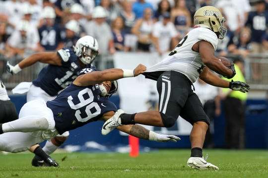 Aug 31, 2019; University Park, PA, USA; Penn State Nittany Lions defensive end Yetur Gross-Matos (99) grabs the jersey of Idaho Vandals running back Aundre Carter (22) during the second quarter at Beaver Stadium. Mandatory Credit: Matthew O'Haren-USA TODAY Sports