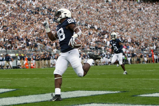 Aug 31, 2019; University Park, PA, USA; Penn State Nittany Lions running back Devyn Ford (28) runs the ball into the end zone for a touchdown against the Idaho Vandals during the second quarter at Beaver Stadium. Mandatory Credit: Matthew O'Haren-USA TODAY Sports