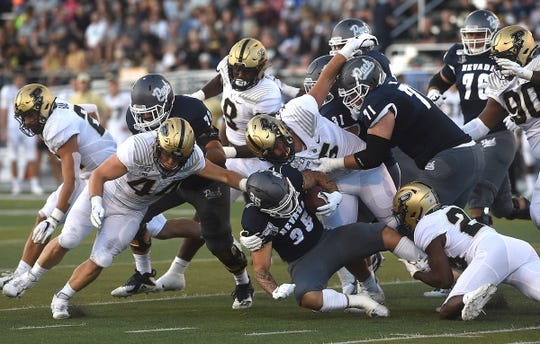 Nevada's Toa Taua led the Wolf Pack in rushing Friday night against Purdue.