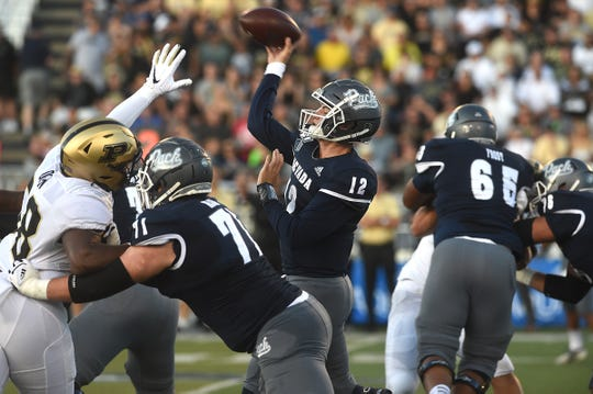 Nevada's Carson Strong (12) throws a pass against Purdue during the Wolf Pack's season-opener at Mackay Stadium.
