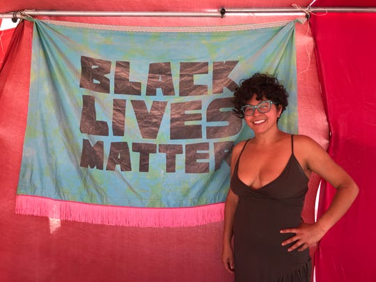 Favianna Rodriguez, an activist and member of the Burning Man community, is pictured at her camp on Saturday, Aug. 31, 2019 in Black Rock City.