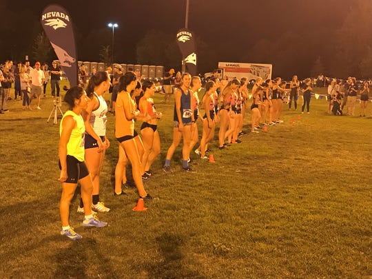 The start of the women's college cross country race Friday night.