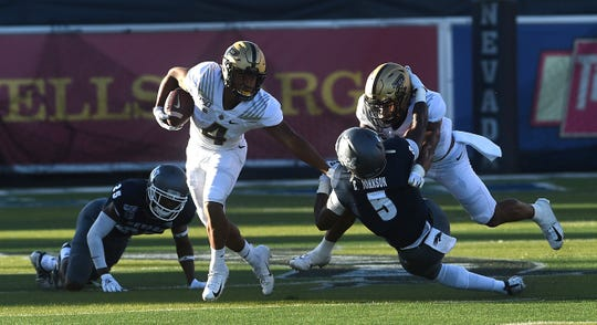 Purdue's Rondale Moore (4) looks to run while taking on Nevada during their football game at Mackay Stadium in Reno on Aug. 30, 2019.