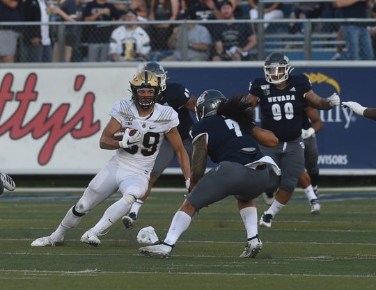 Purdue tight end Brycen Hopkins looks upfield during Friday night's game against Nevada at Mackay Stadium in Reno on Aug. 30,  2019.